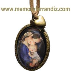 """Medallón bronce con cristal lupa 30 x 40 mm .""""Virgen trenza"""" con cinta de ante y corazón dorado. En bolsita."""